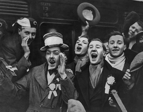 A group of West Ham supporters cheering as they leave Waterloo Station for a match at Boscombe, 22nd August 192