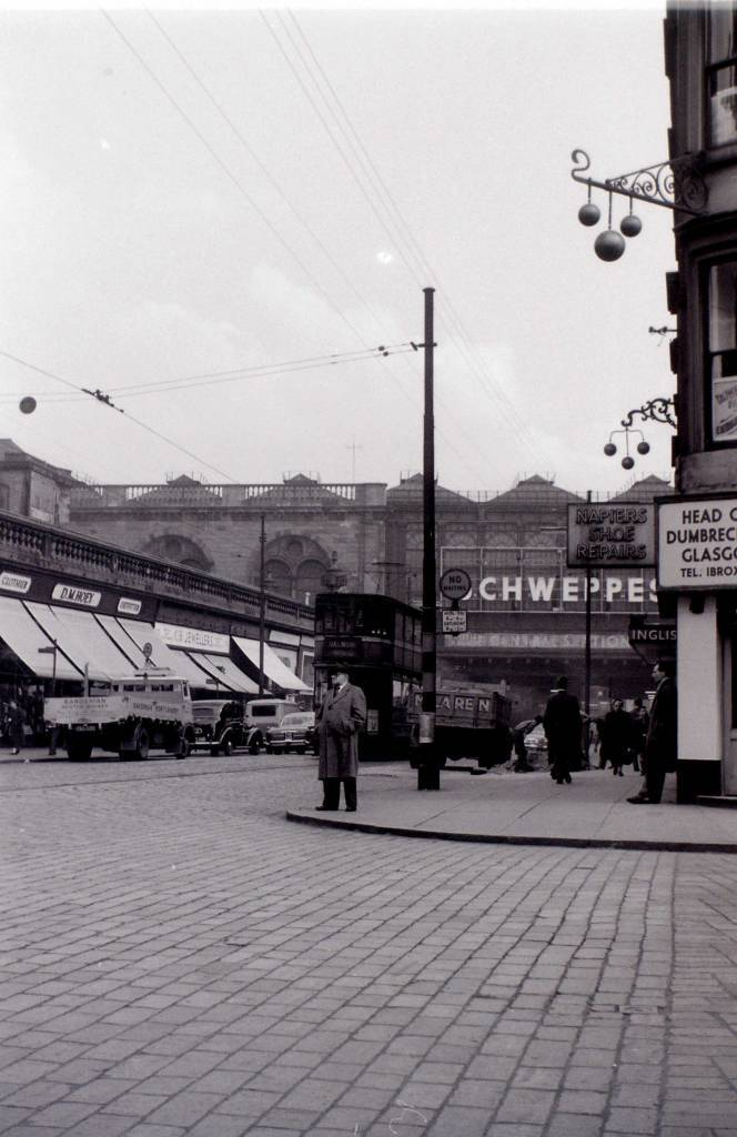 ohn Robertson 6y Argyle Street, the Schweppes sign is on Central Station, above the tunnel underneath it. this was called the Highland Man's Umberella. The noise in there, caused by trains above, and trams could be deafening. The buildings on the left are long gone!!   Alan Morrison 6y as are the buildings on the right, now replaced by the Radisson Hotel