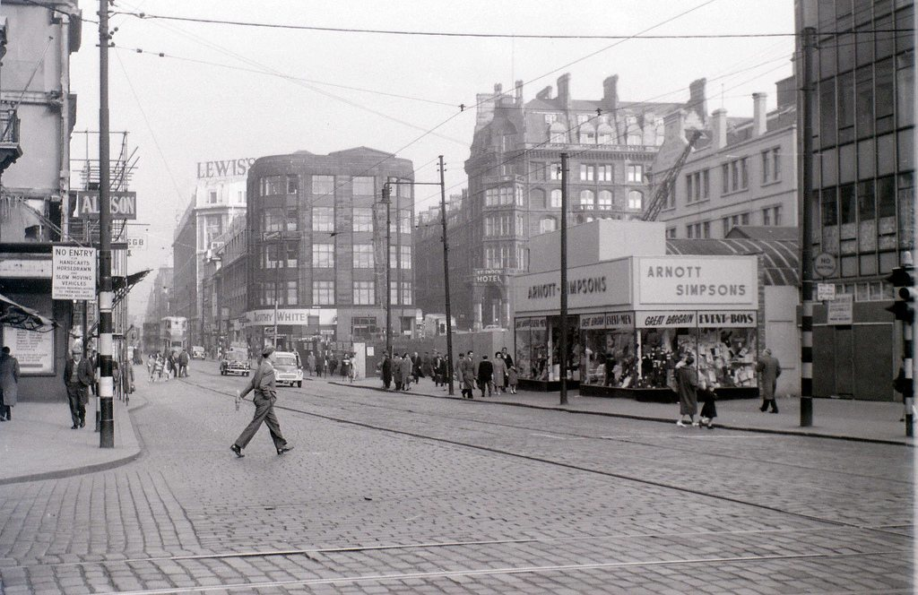 Argyle Street, Lewis's huge department store in the background.   Robert Henderson 6y Lewis's Polytechnic as it was originally known and the St.Enoch Hotel is also visible and so is Timothy Whites. Where the person is crossing over Argyle St. is the site of the famous Boots store or Dissy corner. Note too the Arnott Simpsons store at this time is not the large imposing building that it was to become.   Wee Minxy 6y Oh my goodness...fantastic :)   Robert Pool 6y Robert, Lewis's was originally John Anderson's Royal Polytechnic untill it sold out to lewis's in 1937. As far as l am aware Lewis's never used the 'Polytechnic' in their name of the store. The Boots store was previously the Adelphi Hotel and before that The Argyll Hotel and it would have been to the back of the photographer. The gent crossing the road is in fact coming from Mitchell Street (no entry sign)  see: 1919 John Anderson's Royal Polytechnic Ltd, 67 to 99 Argyle Street, Glasgow by Robert Pool's Glasgow Collection   1950's Adelphi Hotel, Argyle Street, Glasgow by Robert Pool's Glasgow Collection   Stuart McKenna 6y Fantastic picture! I've never see this site without the large Arnotts department store before.   stillucan 4y Love these pics. Beg to differ Robert. The gent is crossing the road from Union Street (Boot's corner). The tram lines and traffic lights are quite clear at junction Argyle/Union/Jamaica. Boot's is not built yet - the buildings on the left were demolished between Union and Mitchell to accomodate new Boots.. The latter cannot be seen in this pic. Boots and Arnott's were both built within the same 2 year period. I was an apprentice in construction of both.   Robert Pool 4y Your quite right it is Union Street. What confused me was the 'No Entry' Sign. I have also discovered that Lewis's did use the 'Royal Polytechnic' in their name from time to time.