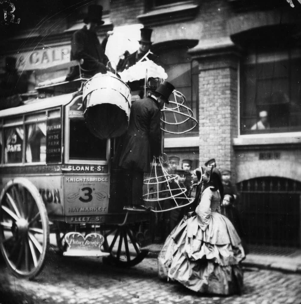 Ladies' crinolines are loaded onto an omnibus going from Sloane Street to Fleet Street, London. London Stereoscopic Company Comic Series   (Photo by London Stereoscopic Company/Getty Images)