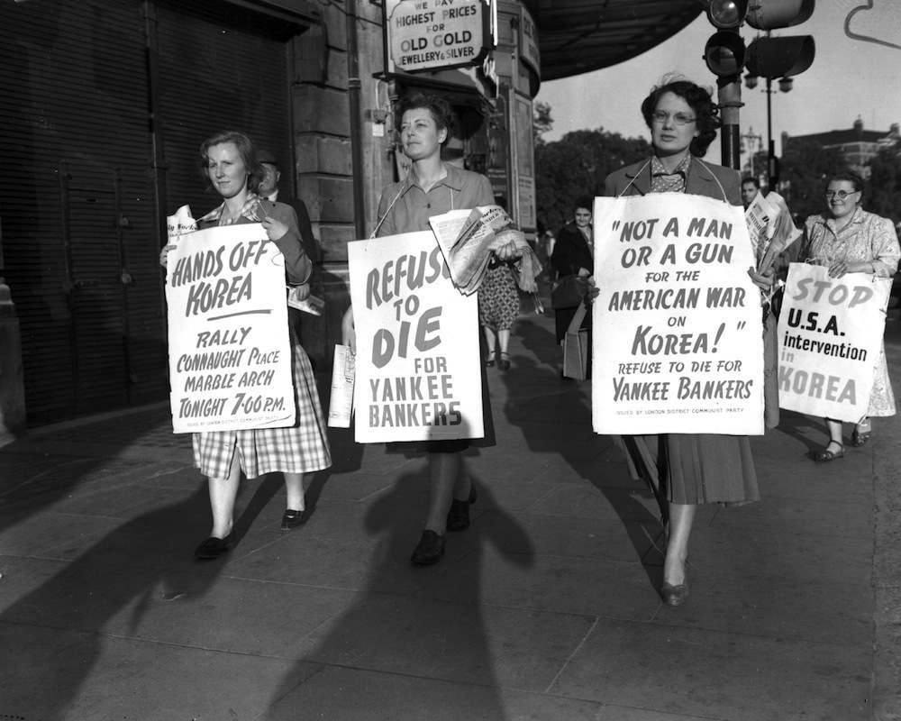 Women with placards demonstrating against the Korean War, as part of the Communist Peace Demonstration held at Marble Arch London. (Photo by Keystone/Getty Images)