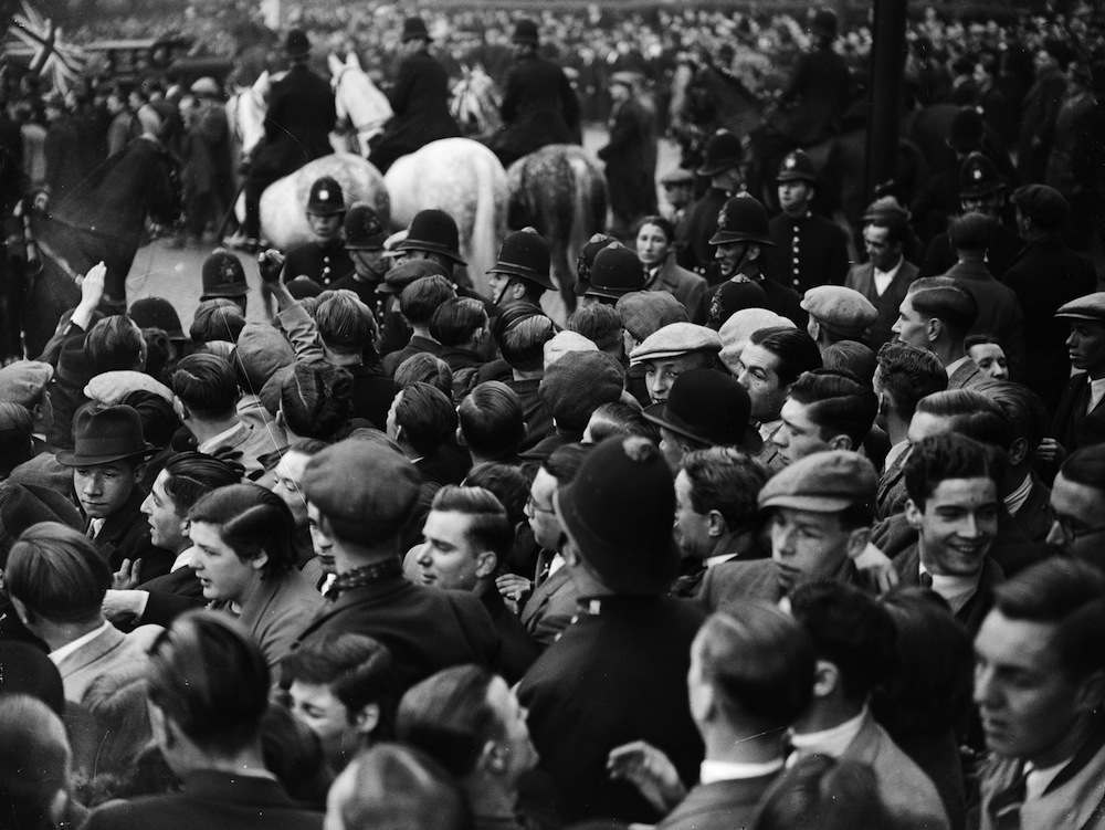 11th October 1936: A heavy police presence at a Communist rally in Victoria Park, London. One young communist raises his hand in a clenched fist salute. (Photo by Fox Photos/Getty Images)