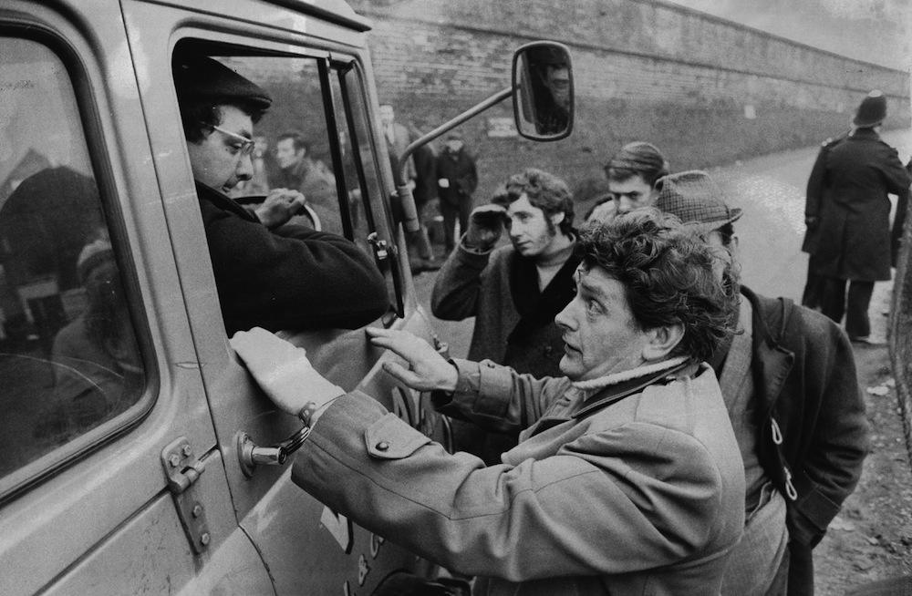 January 1972:  A picket from Warwickshire questions a lorry driver leaving West Drayton National Coal Board Depot at the height of the miners' strike.  (Photo by Evening Standard/Getty Images)