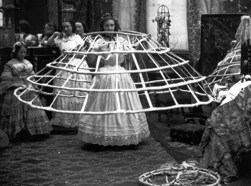 circa 1860:  The scene from a ladies dressing room, preparing for the crinoline.  London Stereoscopic Company Comic Series - 503  (Photo by London Stereoscopic Company/Getty Images)