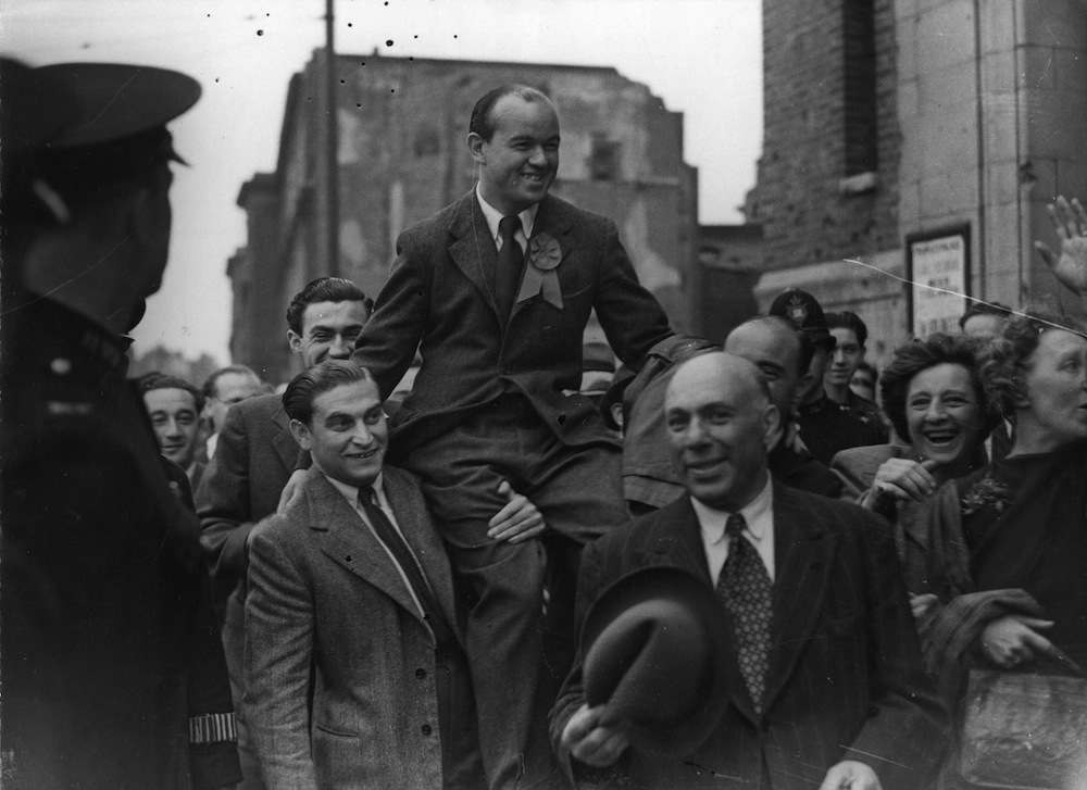 26th July 1945: Communist MP Phil Piratin (1907 - ) is chaired by supporters after winning an election in Mile End, London. (Photo by Keystone/Getty Images)