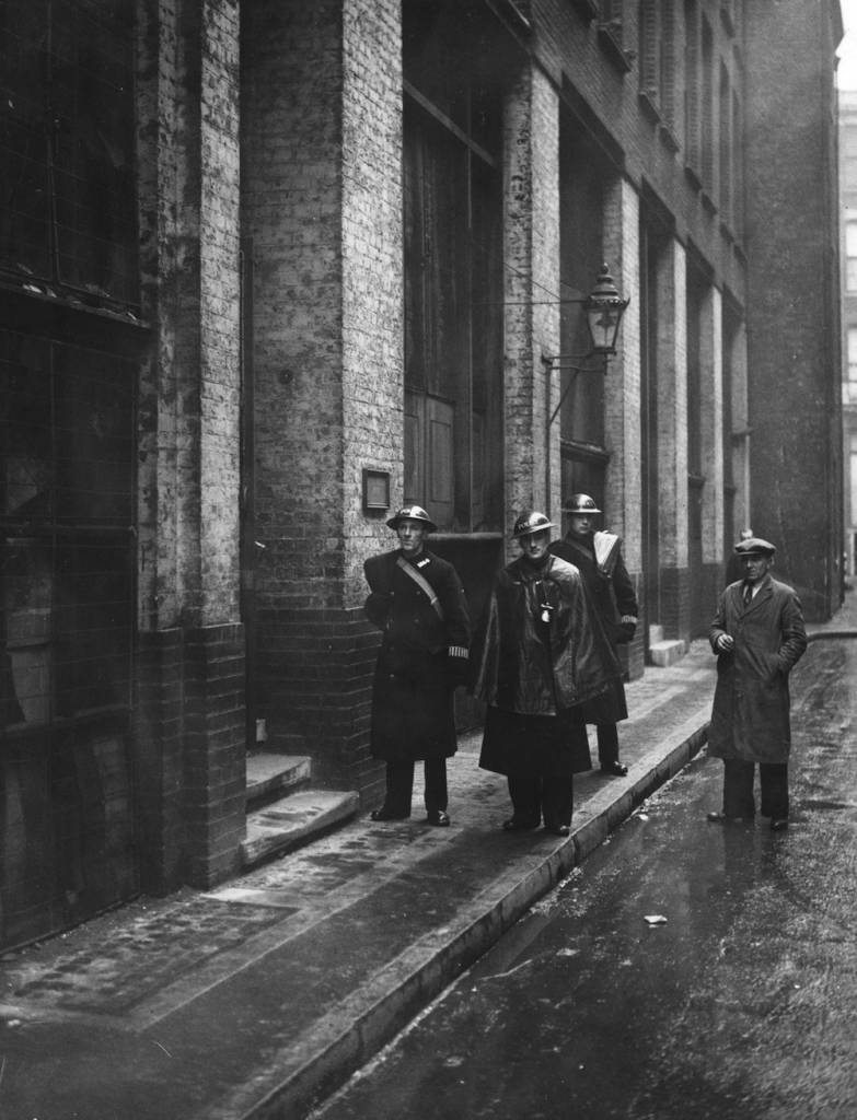 22nd January 1941:  Police on duty outside the offices of 'The Daily Worker' Communist newspaper Cayton Street, East London. On the evening prior to this detectives enforced a suppression order issued against the publication by The Home Secretary, Herbert Morrison. Printing was stopped immediately.  (Photo by Fox Photos/Getty Images)