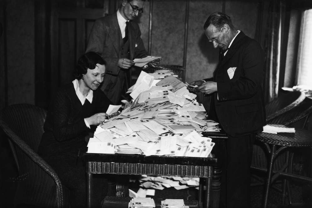 23rd March 1936:  The Arsenal Football Club office staff sort through the huge quantity of post from supporters requesting tickets for the FA Cup Final match between Arsenal and Sheffield Unitied at Wembley Stadium. The club has sold out of its allotted 10,000, so all these applications will be refused.  (Photo by J. A. Hampton/Topical Press Agency/Getty Images)