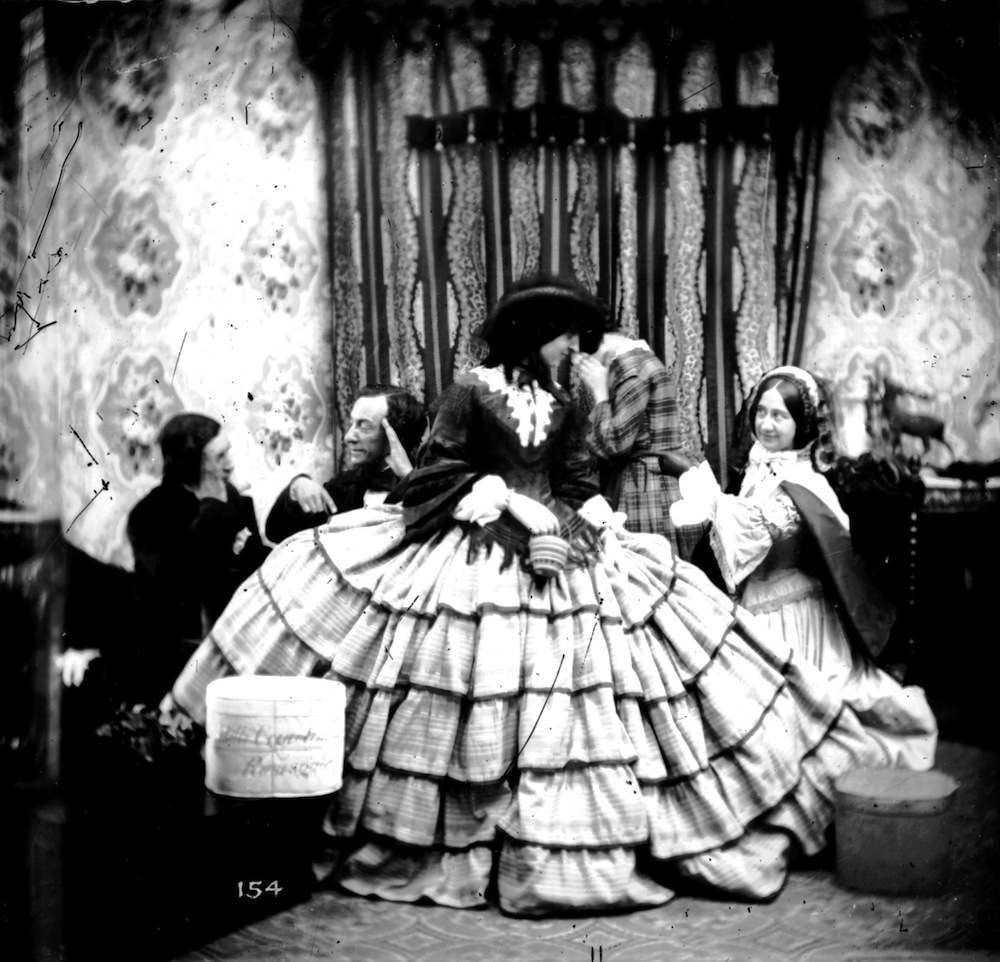 circa 1865:  A woman wearing an exceptionally wide crinoline skirt.  London Stereoscopic Company Comic Series - 154  (Photo by London Stereoscopic Company/Getty Images)