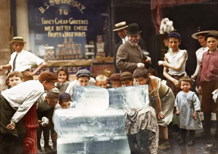 Licking blocks of ice during the heat wave, NYC, (1912)