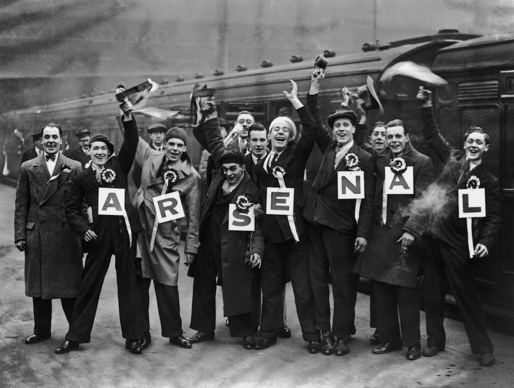 Arsenal fans at Waterloo Station on their way to an F A Cup tie at against Portsmouth at Fratton Park, 13th February 1932. (Photo by S. R. Gaiger/Topical Press/Getty Images)