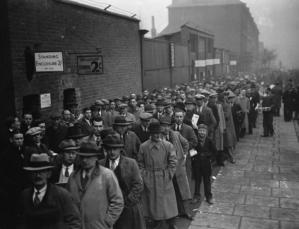 Supporters queuing at the Arsenal Stadium in Highbury for the 3rd round F A Cup tie against Bolton Wanderers, 8th January 1938. (Photo by E. Dean/Topical Press Agency/Getty Images)