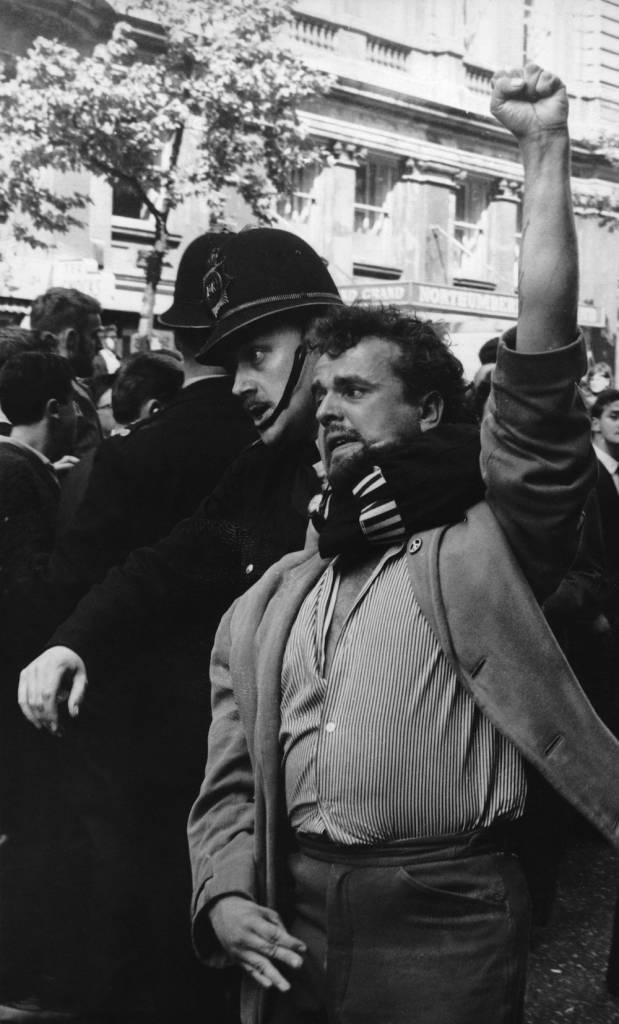 A policeman holds a protestor in a headlock during a demonstration at Trafalgar Square, London, 22nd July 1962. Communists arrived to break up a meeting of the British Union of Fascists, which was to have been addressed by Sir Oswald Mosley. (Photo by Keystone/Hulton Archive/Getty Images)