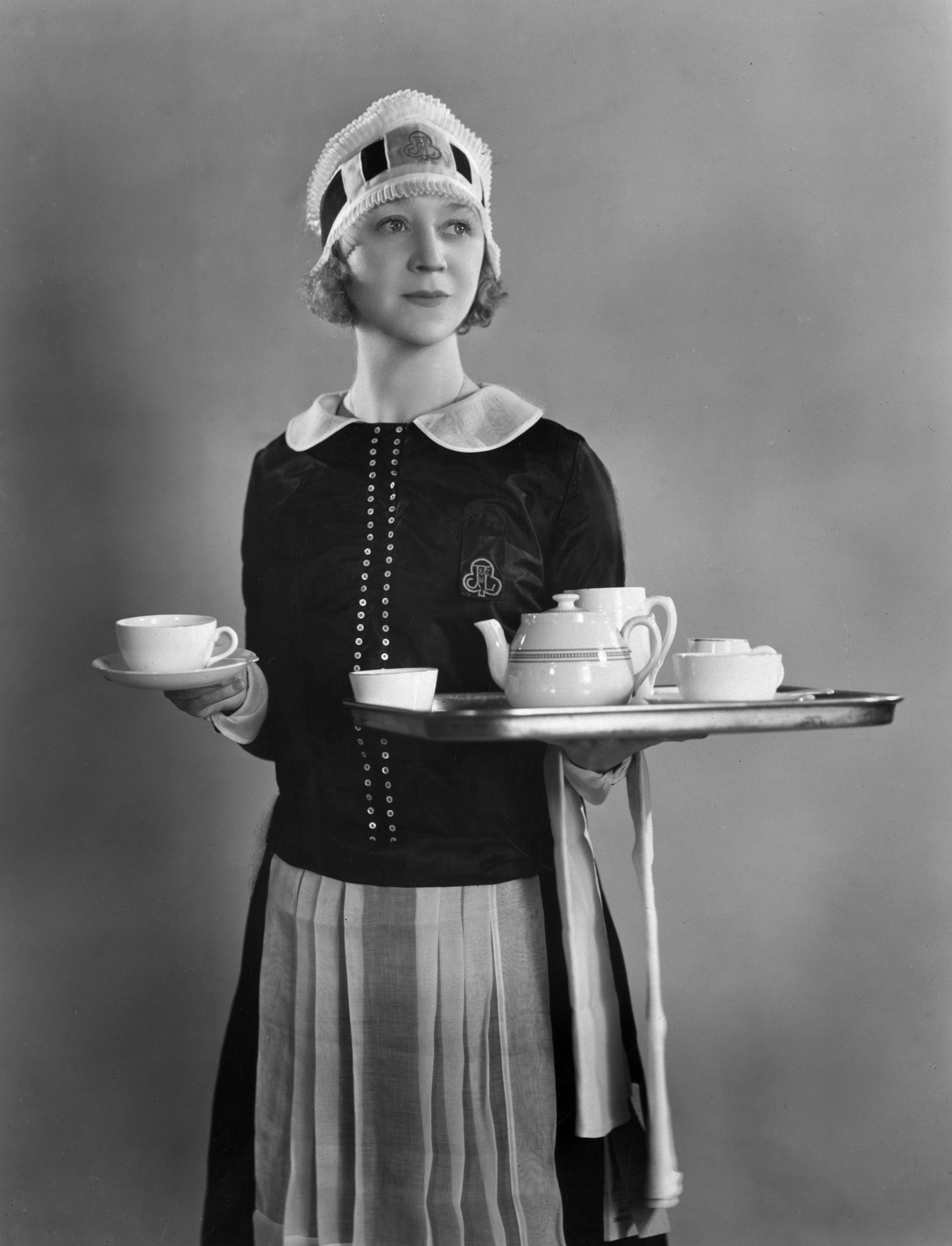 30th August 1930:  British revue comedienne Binnie Hale (1899 - 1984), formerly Beatrice Mary Hale-Monro dressed as a waitress for her part in the Julian Wylie production 'Nippy', showing at the Prince Edward Theatre in London.  (Photo by Sasha/Getty Images)