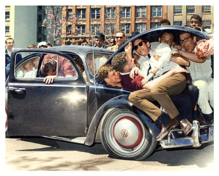 College students pile into a Volkswagen Beetle, (c. 1965)