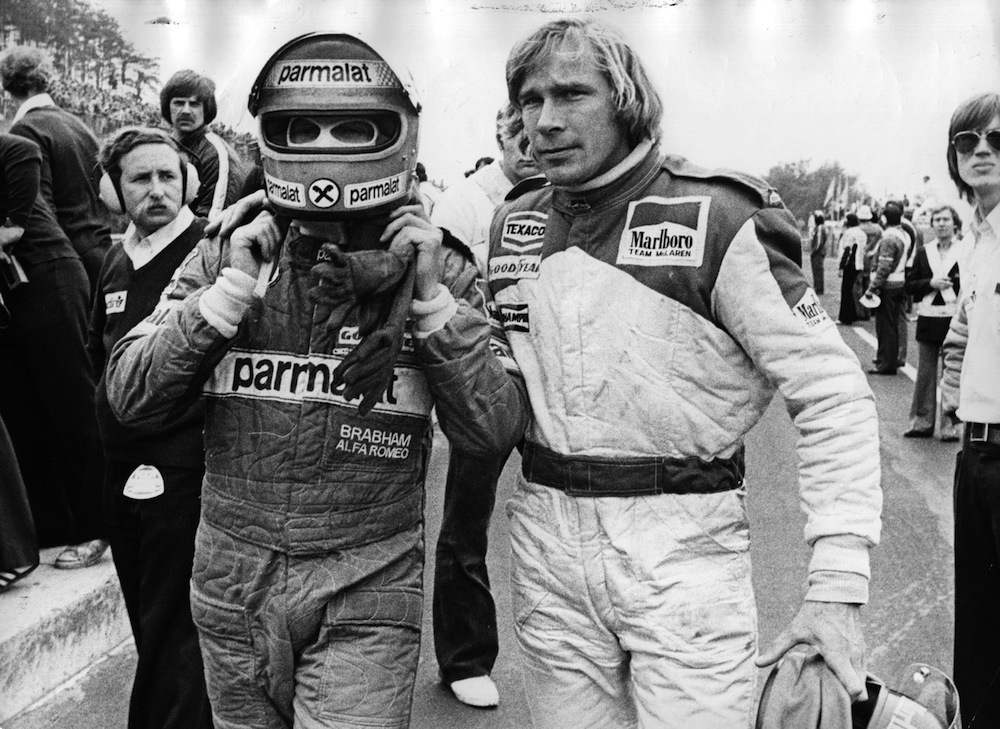 British racing driver James Hunt (1947 - 1993) and Austrian Niki Lauda abandoning the race after they have crashed into each other.   Original Publication: People Disc - HG013   (Photo by Hulton Archive/Getty Images)