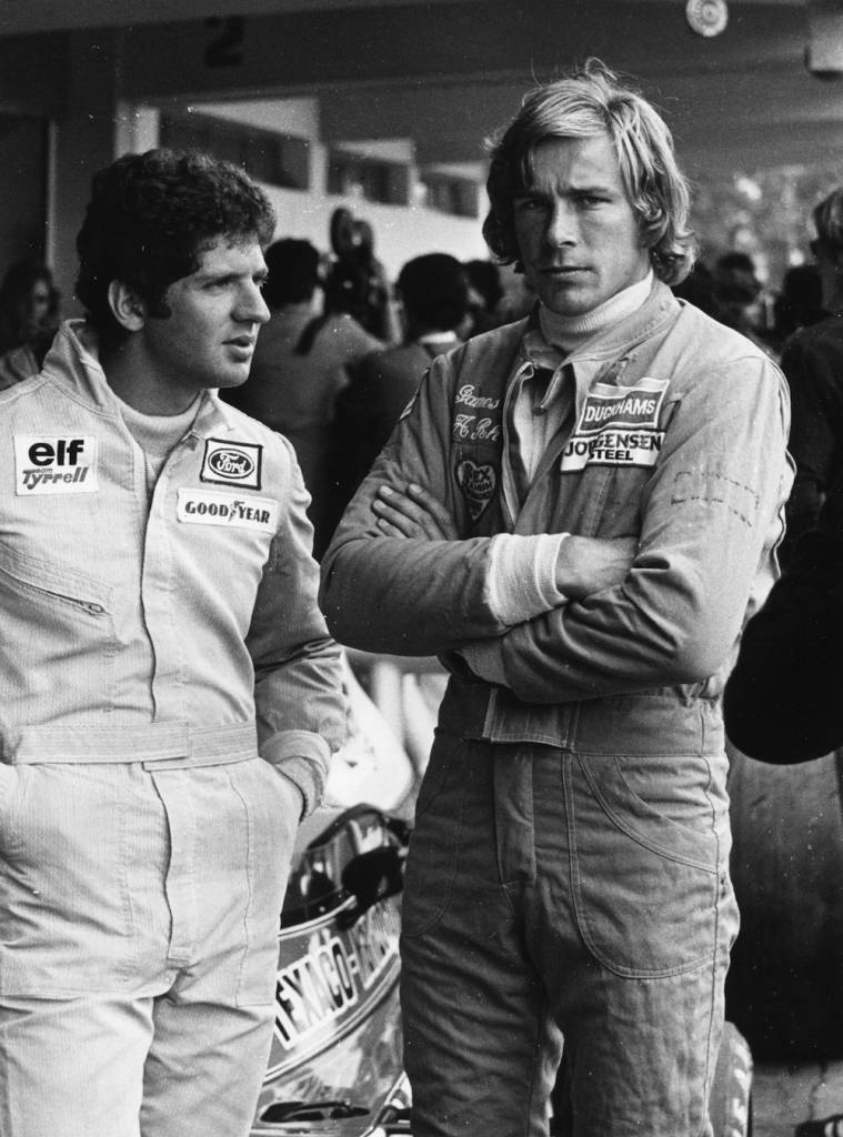 17th January 1975:  British racing driver James Hunt (1947 - 1993), right, with Jody Scheckter of South Africa, at the Argentine Grand Prix in Buenos Aires.  (Photo by Roberto Bunge/Keystone/Getty Images)