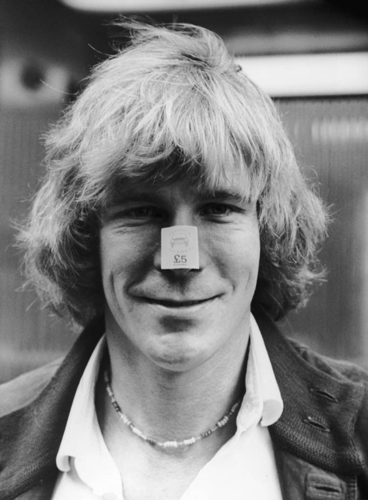 English racing driver James Hunt (1947 - 1993) wearing a vehicle licence stamp on his nose, 11th August 1980. The stamps are part of a Ministry of Transport scheme to help drivers save towards their licences. (Photo by Central Press/Hulton Archive/Getty Images)