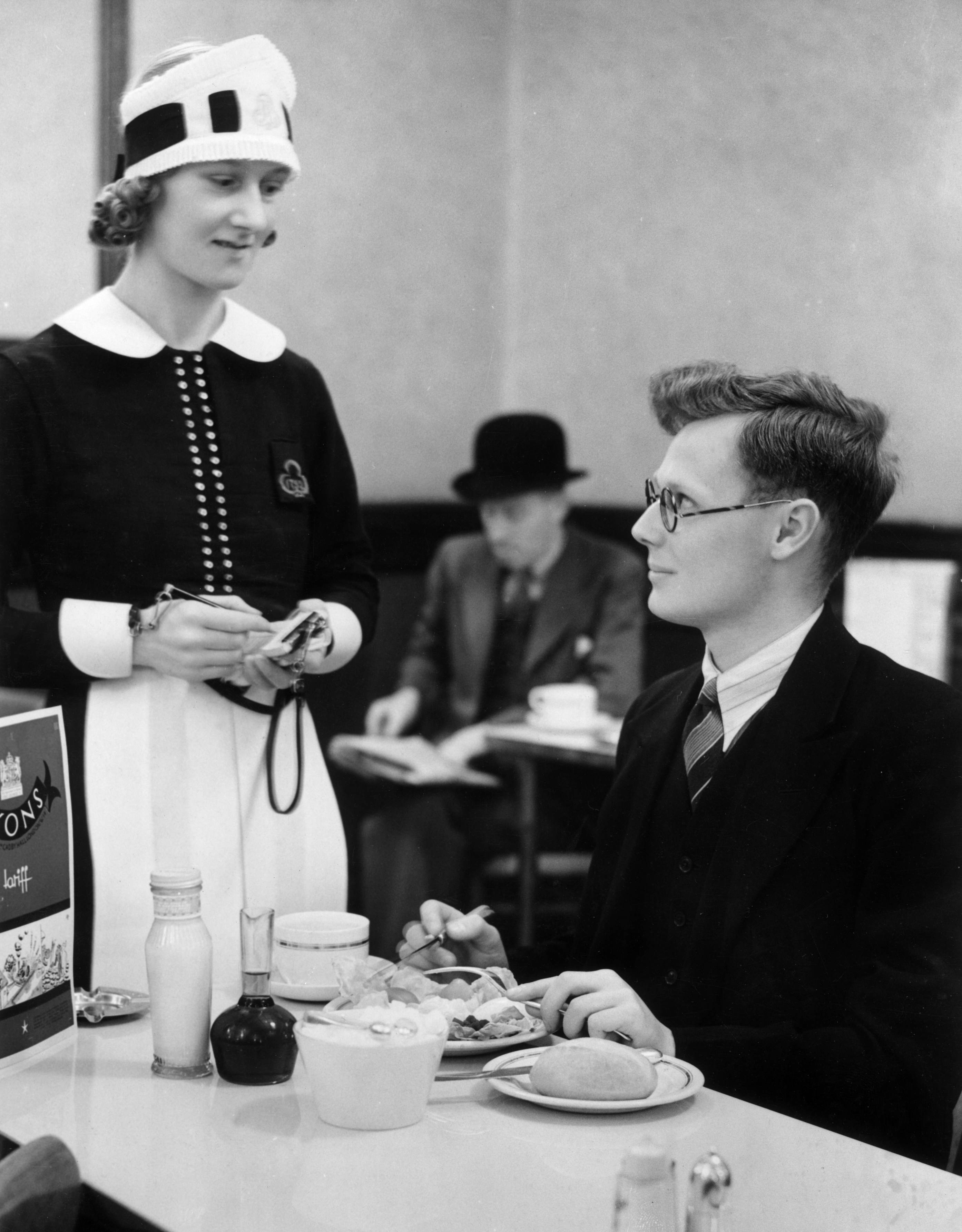 14th July 1939:  Mr Edwin Barrall, an office worker in the City of London enjoys his last 'civvy' lunch at the Lyon's Tea Room in Ludgate Circus. The next day he is to become a militiaman at the Army's headquarters in Aldershot.  (Photo by William Vanderson/Fox Photos/Getty Images)