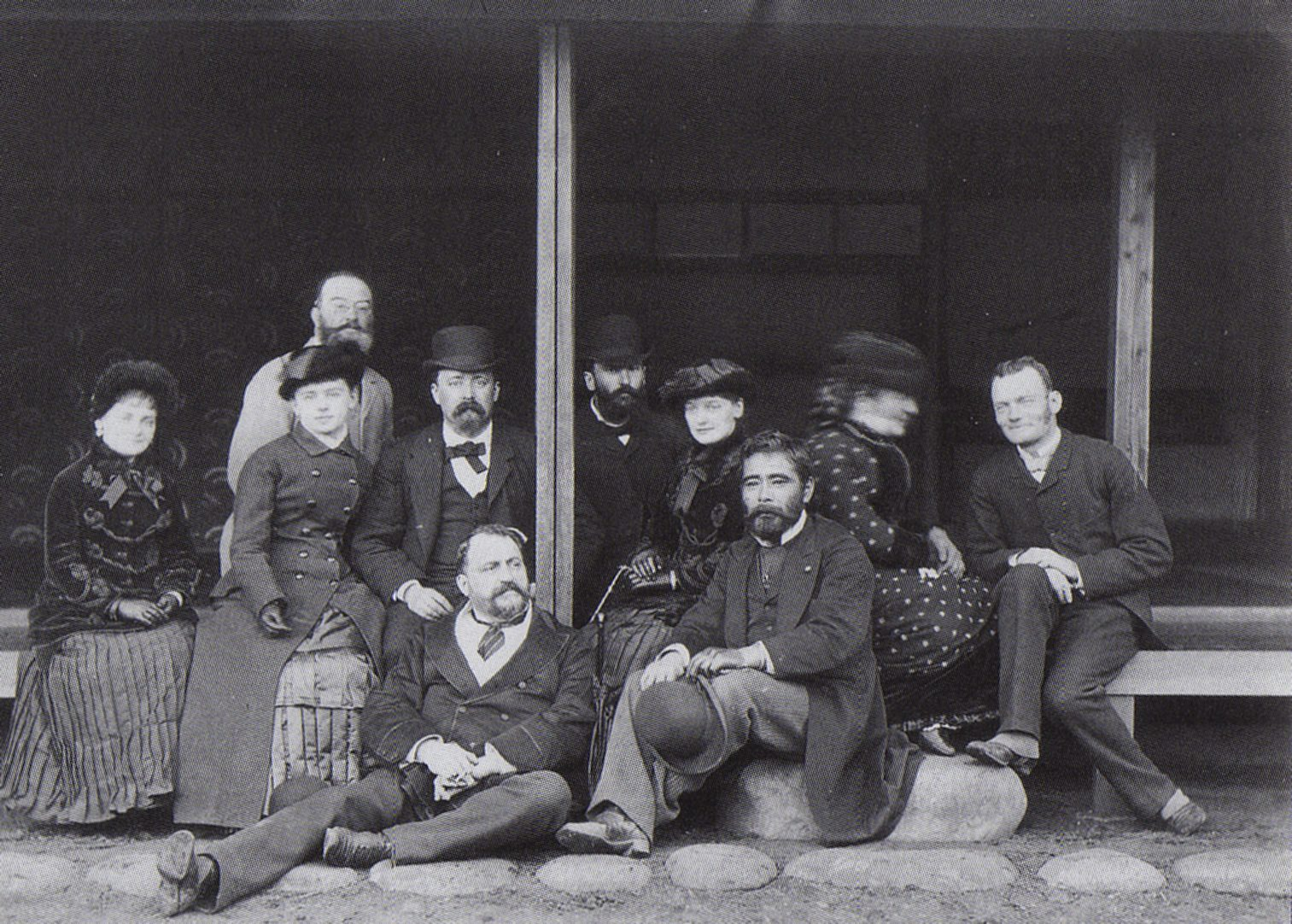 Felice Beato with Saigo Tsugumichi (both seated in front), with foreign friends. Photograph by Hugues Krafft in 1882.