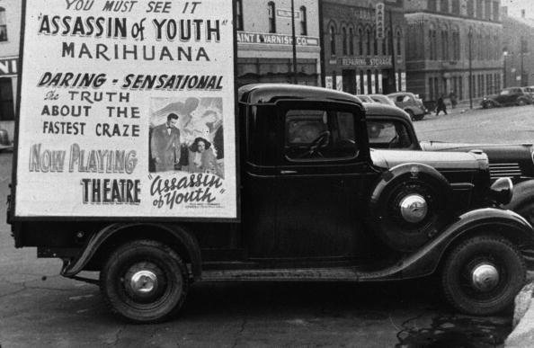 November 1938:  A truck in Omaha, Nebraska, carrying a poster advertising 'Assassin of Youth', a film warning of the dangers of marijuana.  (Photo by John Vachon/Library Of Congress/Getty Images)