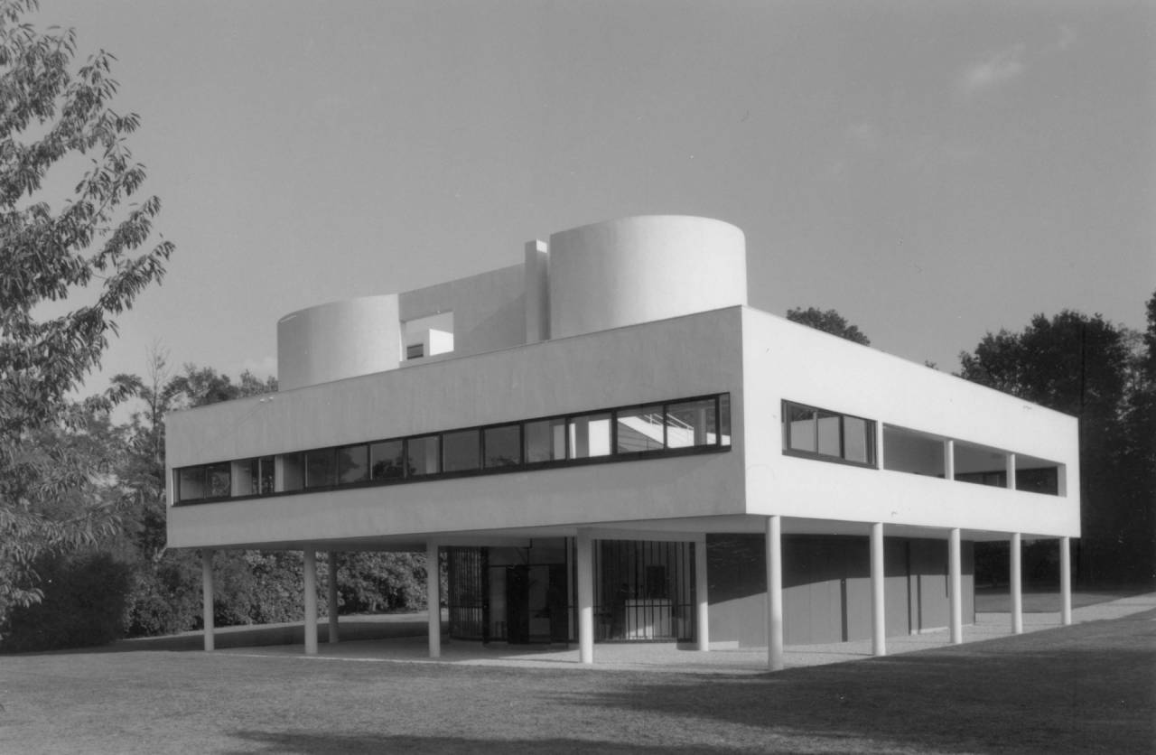 The private dwelling as manifesto. Villa Savoye, designed by Le Corbusier and his cousin Pierre Jeanneret, and built 1928-1931 on the outskirts of Paris, defined a new living space – one shared with machines and automobiles.