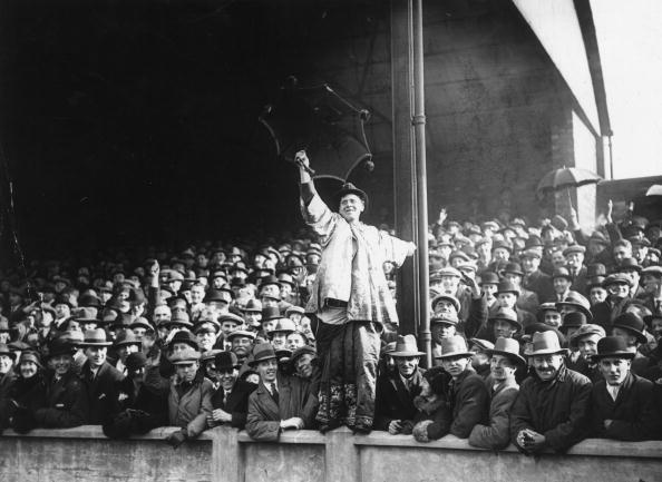 22nd March 1930:  A Hull supporter the crowd before the start of an English semi-final Cup-Tie at Leeds between Arsenal and Hull City.  (Photo by S. R. Gaiger/Topical Press Agency/Getty Images)