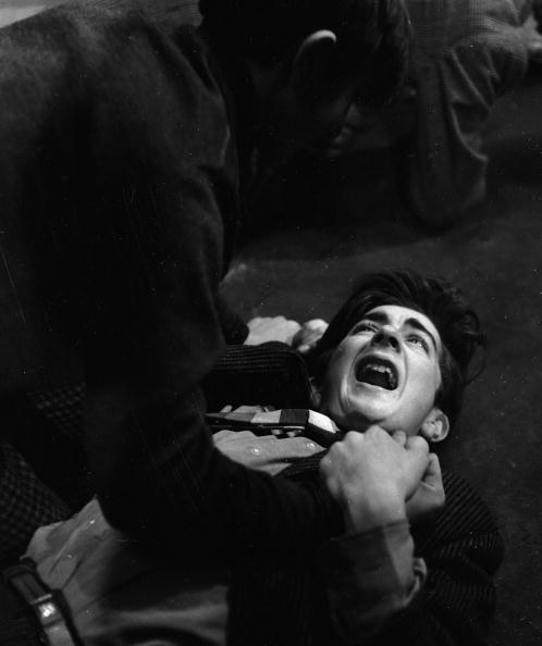 30th October 1962, A punch up in the street, a scene from 'What a Crazy World'. The musical play with words and music by Alan Klein, a 22 year old from London's East End, is being produced at a theatre workshop in the Theatre Royal, Stratford, London.