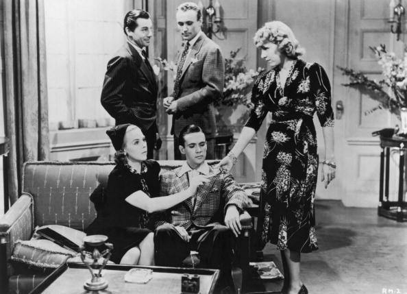 A still from 'Reefer Madness', an anti-drugs exploitation film, dealing with the pitfalls of marijuana smoking, directed by Louis J. Gasnier, 1936. Among the cast are: Standing, left to right: Carleton Young (1905 - 1994), Dave O'Brien (1912 - 1969), and Thelma White (1910 - 2005). Seated on the left is Lillian Miles (1907 - 1972).  (Photo by Hulton Archive/Getty Images)