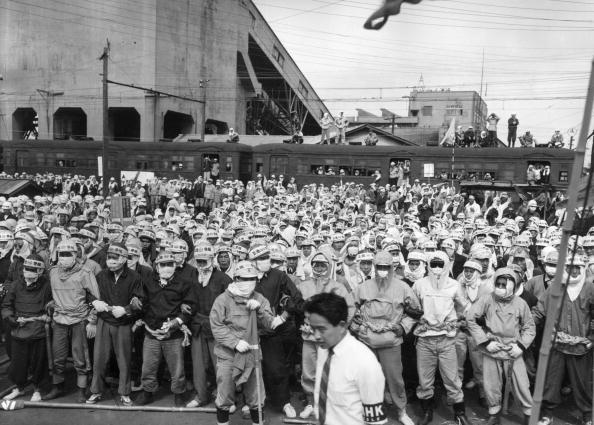 19th May 1960: Japanese coal miners, wearing protective clothing, form a human barricade to prevent strikebreakers from entering the Mitsui Miike mine at Kumamoto.