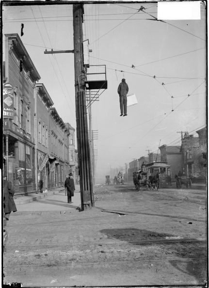 Effigy of Frank Curry, strike-breaker, hanging over 42nd Street and Wentworth Avenue during the Chicago City Railway Strike, Chicago, Illinois, November 19, 1903.