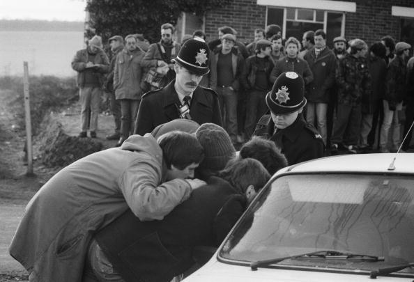 Members of a miners' picket at Tilmanstone Colliery, Kent, try to persuade a colleague not to cross the picket line, in the last days of the miners' strike, March 1985. The miners of Tilmanstone were one of the last groups to return to work after the strike.