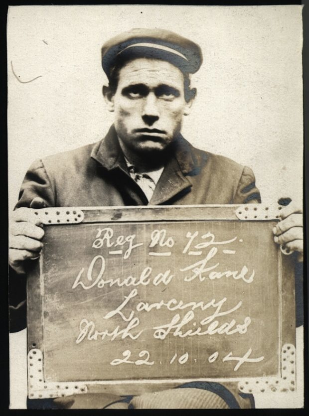 "Name: Donald Kane Arrested for: Larceny Arrested at: North Shields Police Station Arrested on: 22 October 1904 Tyne and Wear Archives ref: DX1388-1-59-Donald Kane   The Shields Daily Gazette for 24 October 1904 reports:   ""THEFT FROM A SCHOONER. SEAMAN SENT TO PRISON   At North Shields, Donald Kane, seaman, Dumbarton, was charged with having stolen between 21st and 22nd inst. clothing and other articles from the schooner Agnes lying in the Albert Edward Dock. The first charge was that of stealing a jacket, vest and pocket book, value £2, the property of W.E. Coulthorpe, the master of the vessel. The second was of stealing a jacket and a Naval Reserve book, value 10s, the property of James Stewart, able seaman and the third charge was of stealing a pair of boots, value 5s 11d, the property of Chas. Henry Briscoe."