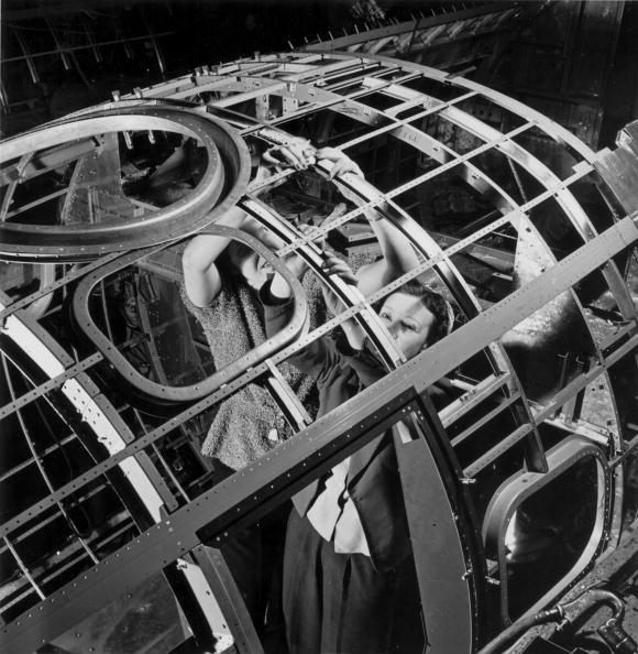 circa 1943:  Women working on a fuselage framework in the Boeing aircraft plant , Seattle, Washington.  (Photo by MPI/Getty Images)
