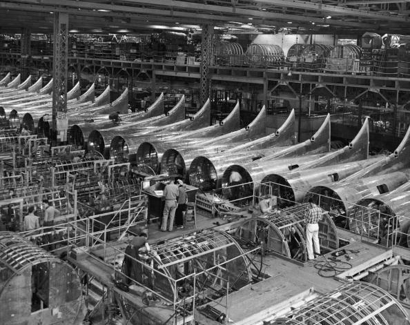 December 1942:  High-angle view of the fuselage frameworks for B-17 F (Flying Fortress) bombers under construction at the Boeing plant in Seattle, Washington, World War II.  (Photo by Anthony Potter Collection/Getty Images)
