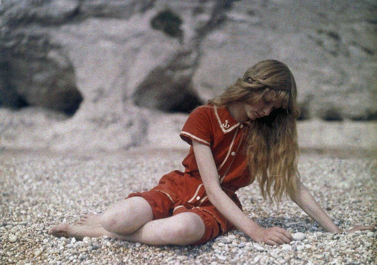 July 13 1913 Christina O'Gorman, photographed by her father at Lulworth Cove, Dorset, England. Christina's choice of swimming costume was a fortuitous one since red was a colour which the Autochrome process captured particularly well.