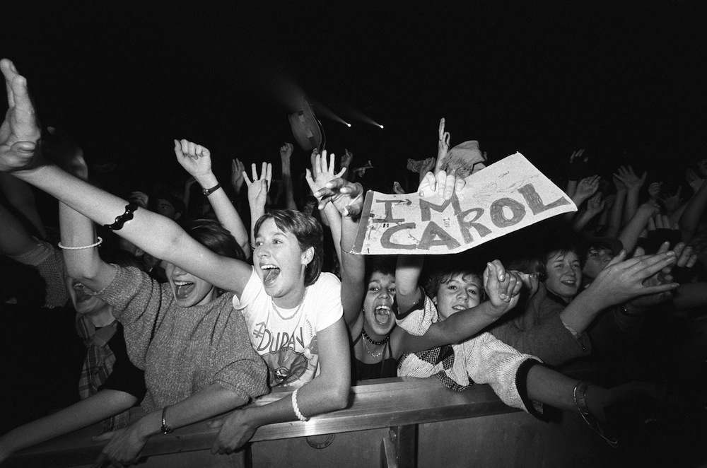 Screaming Duran Duran fans in the front row during a concert held at Wembley Arena in London, England on December 19, 1983. (Photo by Rogers/Express/Getty Images)