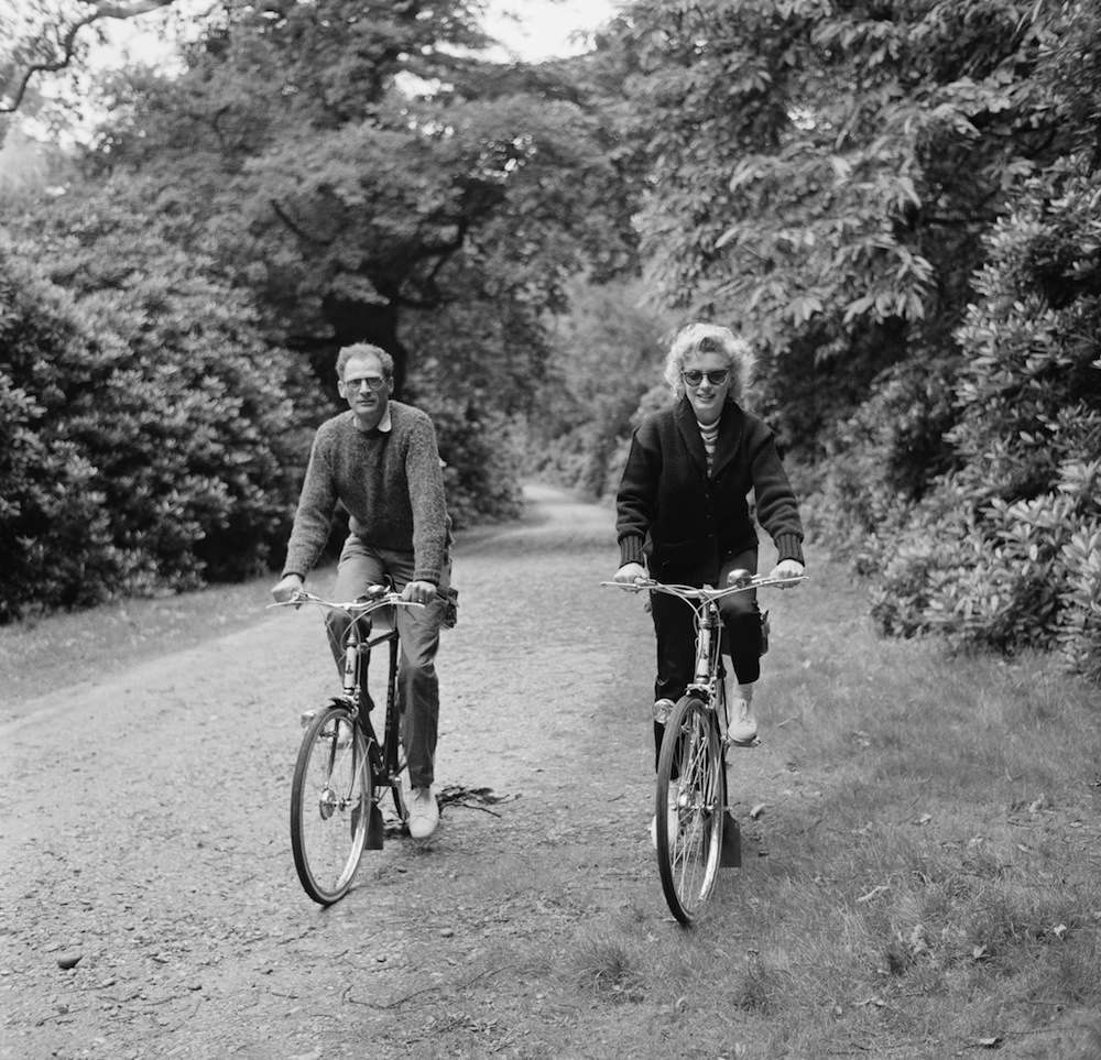 August 13, 1956. American actress Marilyn Monroe (1926 - 1962) out for a cycle ride with her third husband, American dramatist Arthur Miller (1915 - 1905), 13th August 1956. (Photo by Harold Clements/Daily Express/Hulton Archive/Getty Images)