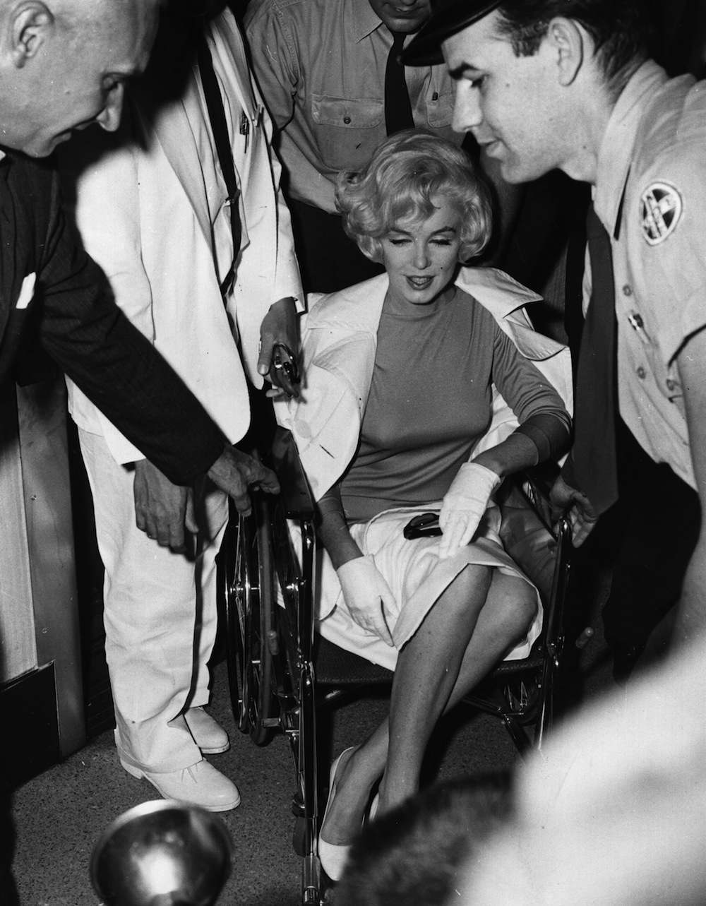 1961. American film star Marilyn Monroe (Norma Jean Mortenson or Norma Jean Baker, 1926 - 1962) leaving the Pollyclinic in Manhattan, after her gall bladder operation.  Original Publication: People Disc - HW0705   (Photo by Express Newspapers/Getty Images)