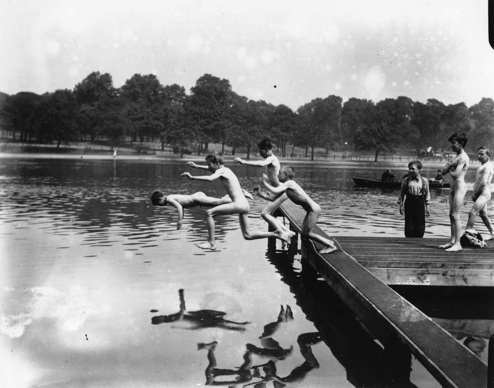 A group of naked boys jumping into the lake at Hyde Park during a heat wave.   (Photo by Topical Press Agency/Getty Images)