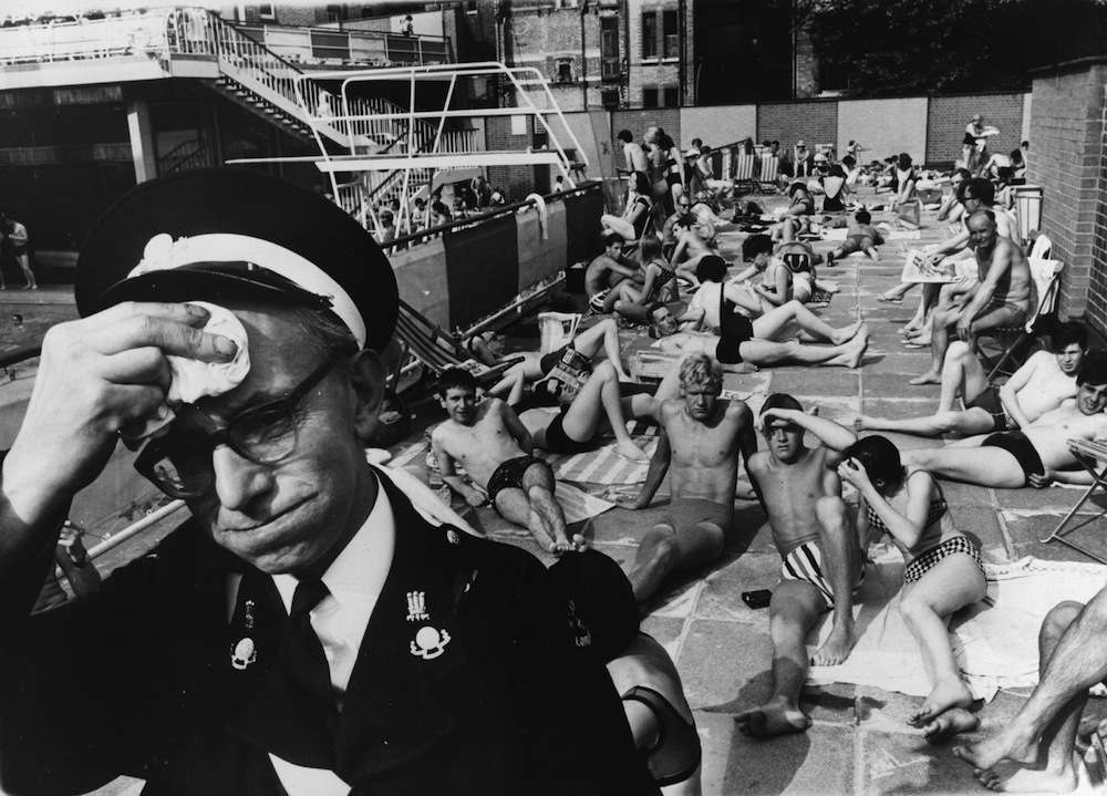 An ambulance man on duty at the Holborn Oasis swimming pool, London, suffering in the July heat.   (Photo by Keystone/Getty Images)January 01, 1964