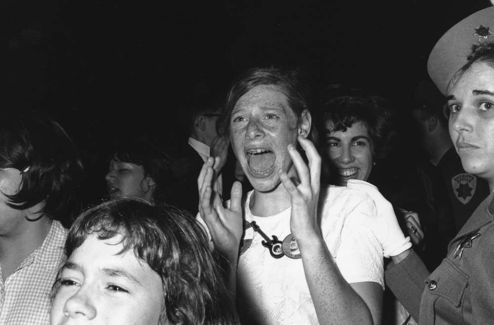 A teenage Beatle fan in hysterics as she catches a glimpse of her heroes.    (Photo by William Lovelace/Getty Images)