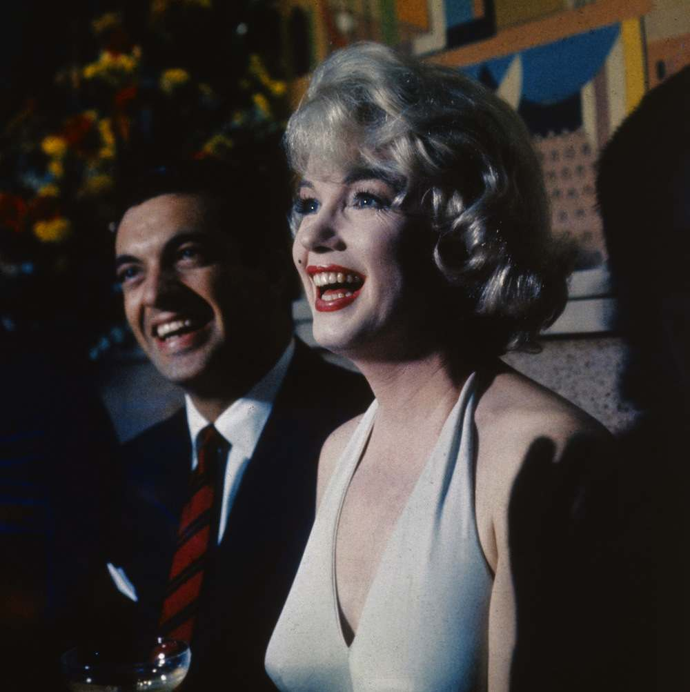 1960:  American actress Marilyn Monroe (1926-1962) and British song and dance man Frankie Vaughan (1928 - 1999), stars of the film 'Let's Make Love', directed by George Cukor.  (Photo by Hulton Archive/Getty Images)