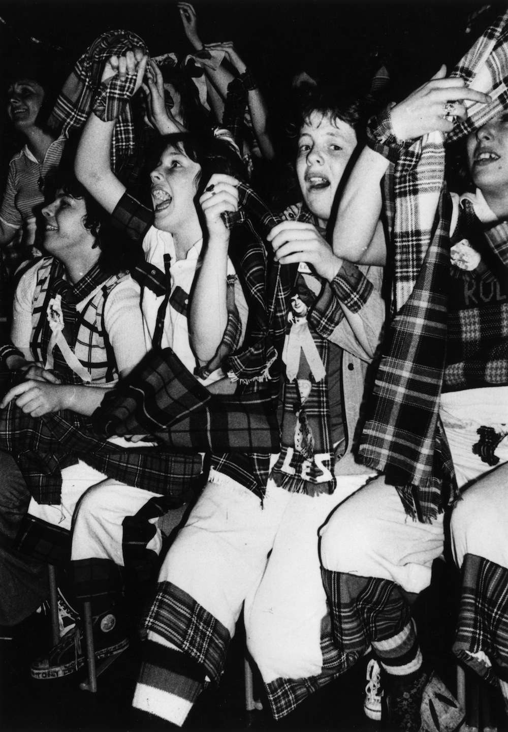 22nd May 1975:  Ecstatic tartan-clad Bay City Roller fans at a concert in Swansea, where 16 of them had to be taken to hospital  (Photo by Graham Wood/Evening Standard/Getty Images)