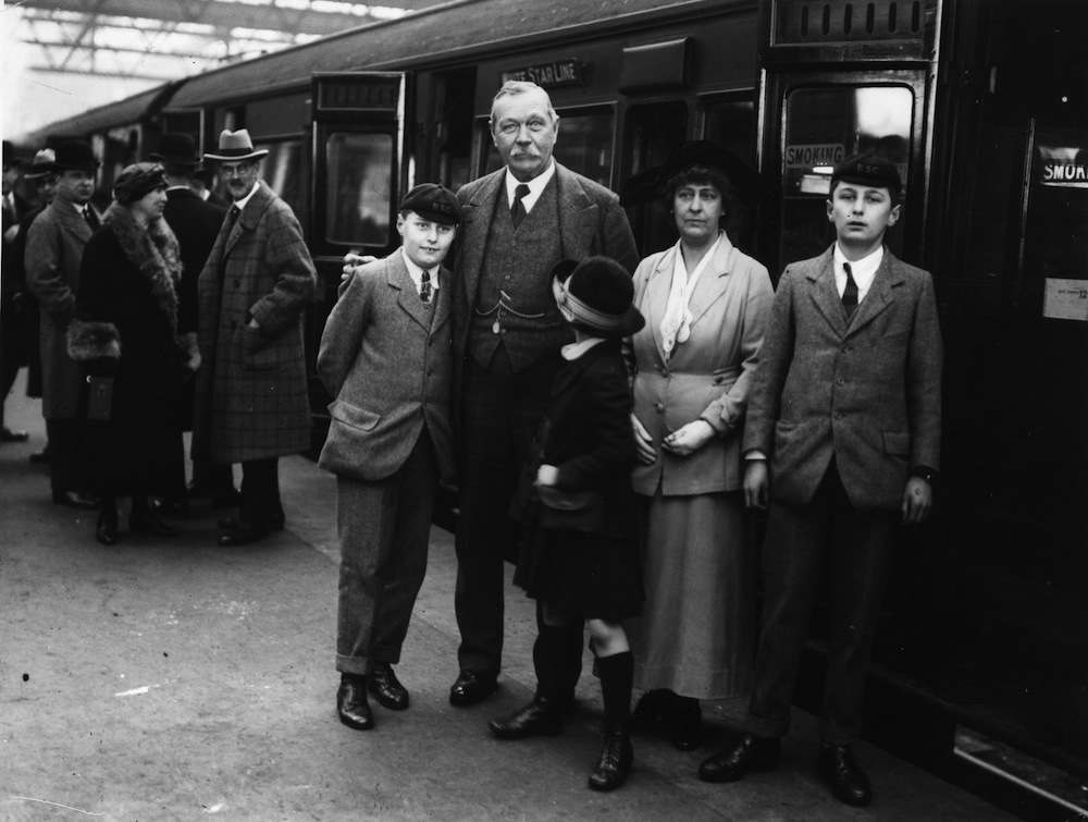 March 1923:  Writer of the Sherlock Holmes mysteries, Dr Arthur Conan Doyle (1859 - 1930) with his family on Waterloo station en-route for the USA.  (Photo by Topical Press Agency/Getty Images)