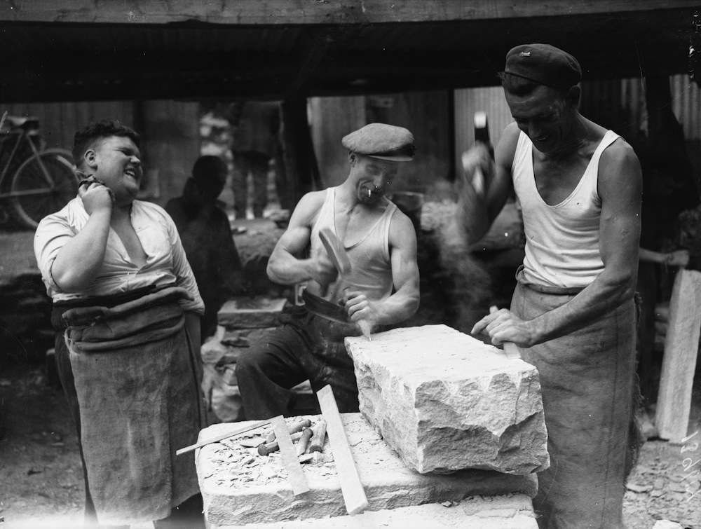 23rd  July 1936:  Welsh quarrymen work in their vests during a heatwave in Abercarn, Monmouthshire.  (Photo by Richards/Fox Photos/Getty Images)