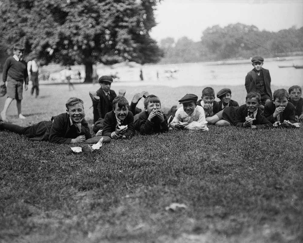 August 1919:  London schoolboys relax in the park during a heatwave.  (Photo by Topical Press Agency/Getty Images)