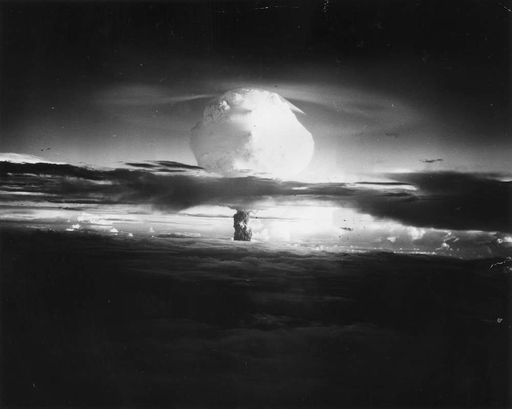 1952:  The mushroom cloud of fire and smoke rises 40,000 feet in two minutes after the Hydrogen Bomb explosion at Eniwetok Atoll in the Pacific.  (Photo by Three Lions/Getty Images)