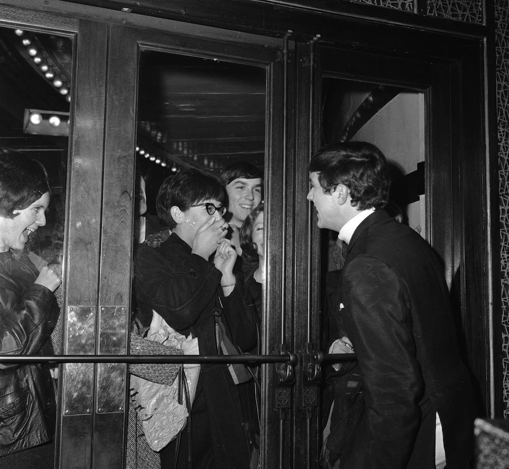 January 1964:  Dave Clark, drummer in his band the Dave Clark Five, besieged by fans outside The Royal in Tottenham, London.  (Photo by Chris Ware/Keystone Features/Getty Images)