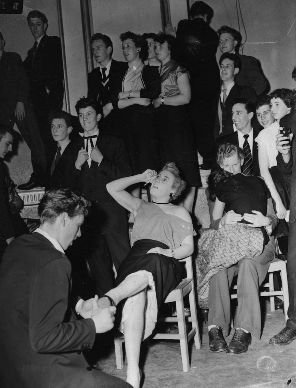 18th February 1954:  Jazz fans collapsed onto chairs, overcome with emotion, at a crowded dance hall where their idols of song Ted Heath, Dickie Valentine and Lita Roza are performing.  (Photo by Keystone/Getty Images)
