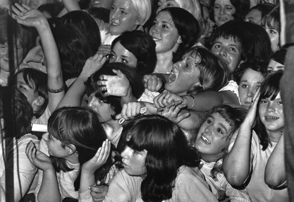 14th August 1964:  Rolling Stones fans watching the band in concert at the Wimbledon Palais, London.  (Photo by Davies/Express/Getty Images)